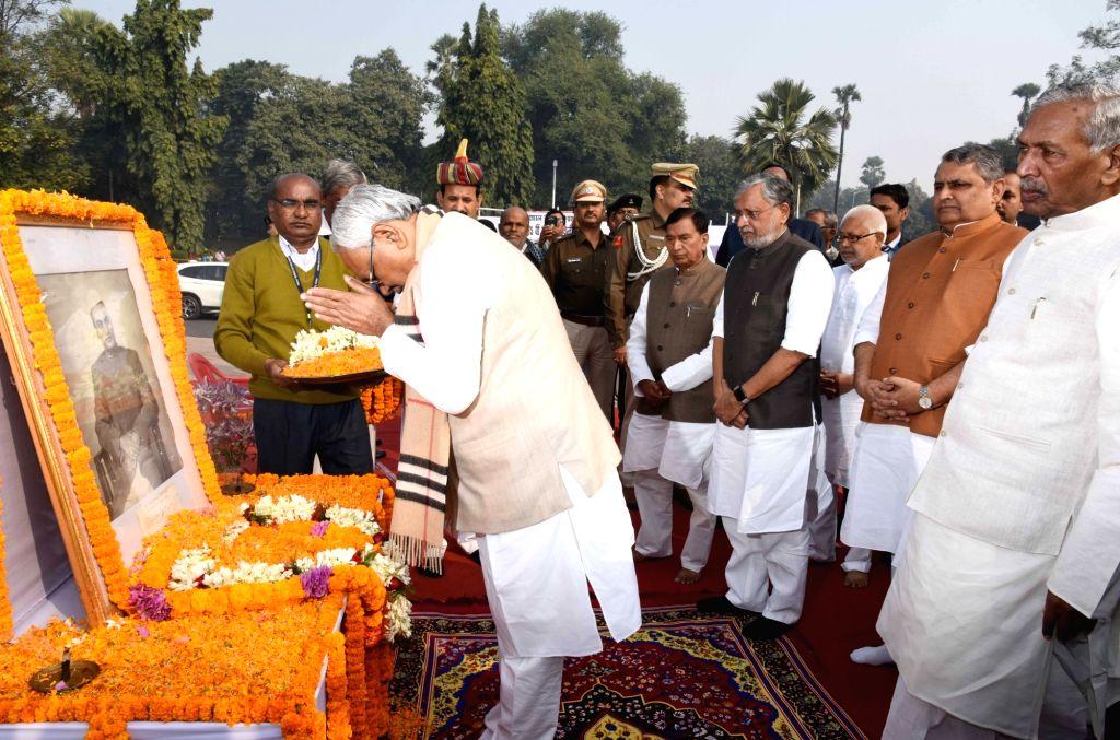 Bihar Governor Phagu Chauhan and Chief Minister Nitish Kumar accompanied by Deputy Chief Minister Sushil Kumar Modi, pay tributes to India's first President Rajendra Prasad on his 135th birth ... - Nitish Kumar, Phagu Chauhan and Sushil Kumar Modi