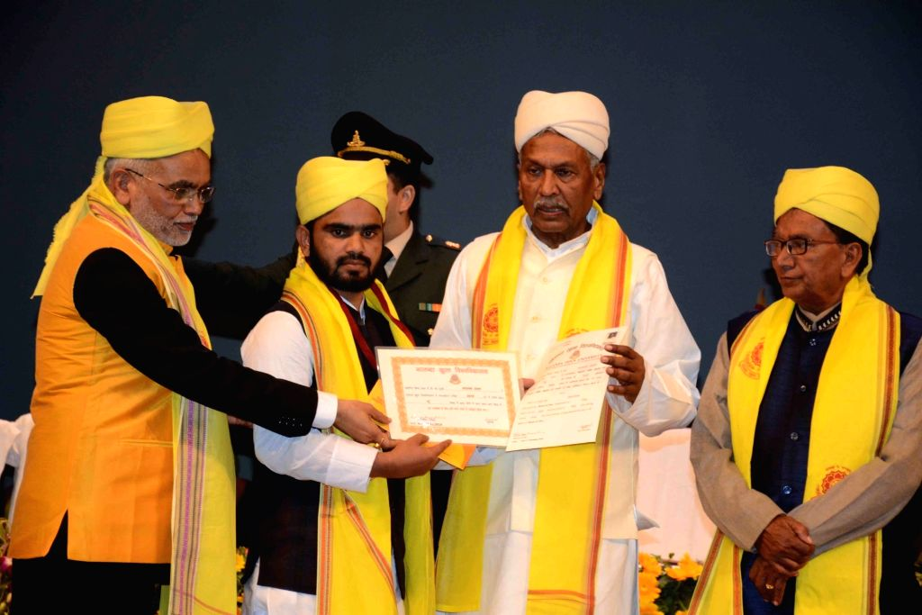 Bihar Governor Phagu Chauhan awards degree to a student during the Convocation ceremony of Nalanda Open University, in Patna on Dec 11, 2019. - Phagu Chauhan