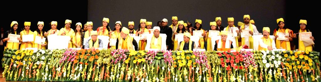 Bihar Governor Phagu Chauhan poses for a group photograph with the students after awarding their degrees during the Convocation ceremony of Nalanda Open University, in Patna on Dec 11, 2019. - Phagu Chauhan