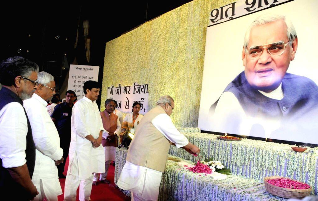 Bihar Governor Satya Pal Malik pays tributes to former Prime Minister Late Atal Bihari Vajpayee during a prayer meeting organised in his memory, in Patna on Aug 21, 2018. Also seen Bihar Chief ... - Late Atal Bihari Vajpayee, Malik, Nitish Kumar, Sushil Kumar Modi and Nityanand Rai
