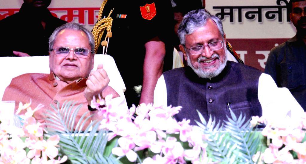 Bihar Governor Satyapal Malik and Deputy Chief Minister Sushil Kumar Modi during a programme, in Patna on June 14, 2018. - Sushil Kumar Modi and Malik