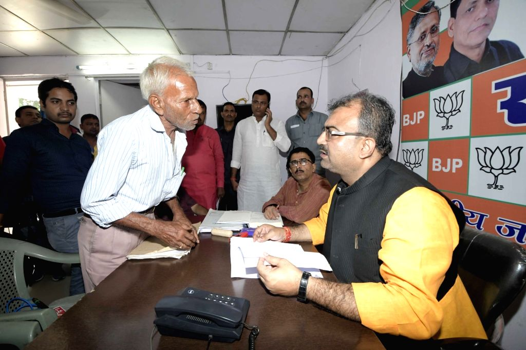 Bihar Health Minister and BJP leader Mangal Pandey listens to public grievances at party office in Patna on Sept 18, 2018. - Mangal Pandey