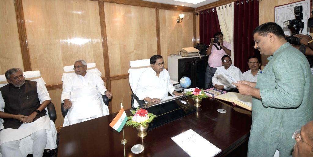 Bihar Legislative Council Chairman Mohammad Haroon Rashid??? administers the oath of office to the newly elected JD-U MLC Sanjay Jha, in Patna on June 4, 2019.