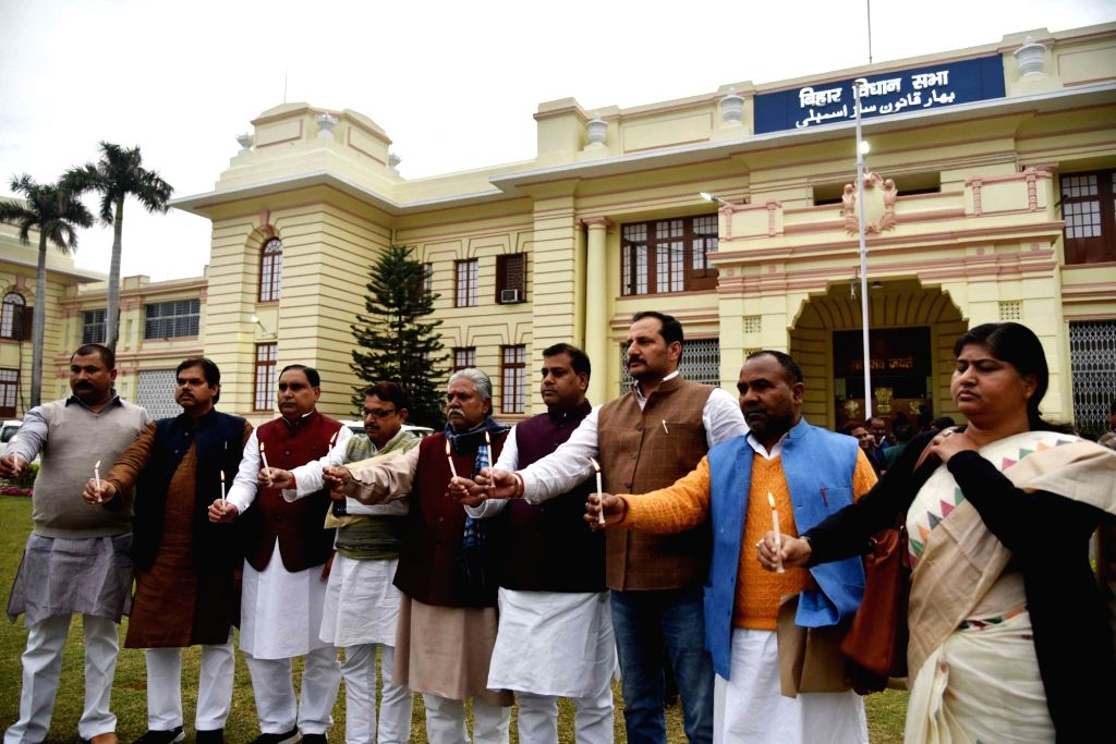 Bihar legislators protest against suicide attack on a CRPF bus in Jammu and Kashmir's Pulwama district in which atleast 45 soldiers lost their lives; at Bihar Assembly in Patna on Feb 15, ...