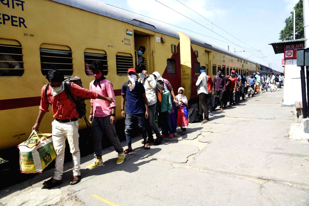 Bihar migrants who were stuck in Karnataka due to the ongoing nationwide lockdown imposed to mitigate the spread of coronavirus, arrive at Patna's Danapur railway station after returning from ...