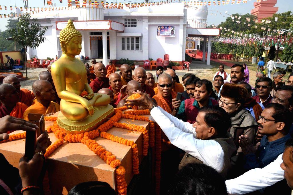 Bihar Minister Krishnanandan Rai pays tributes to Lord Buddha at the inauguration of Jarasandh Buddha Memorial Trust Building in Patna on Dec 6, 2019. - Krishnanandan Rai