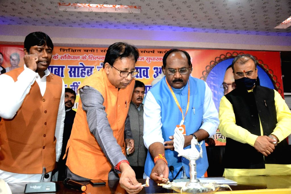 Bihar Minister Mangal Pandey and State BJP President Sanjay Jaiswal during a programme organised on the death anniversary of BR Ambedkar, in Patna on Dec 5, 2020. - Mangal Pandey