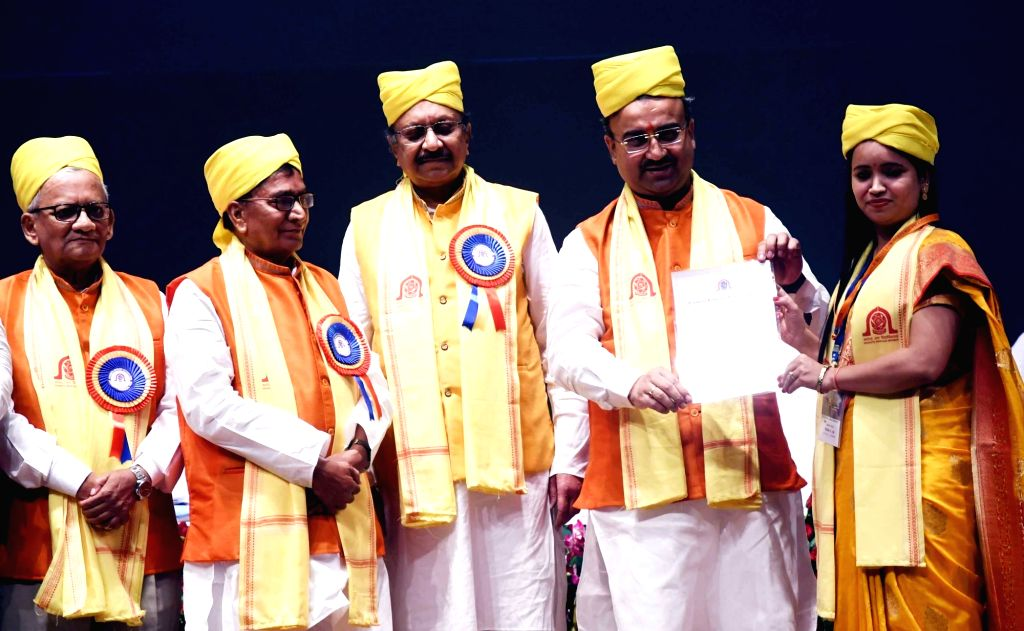 Bihar Minister Mangal Pandey gives away degree to a student during the 6th annual convocation of Aryabhatta Knowledge University (AKU) at Bapu Sabhagar in Patna, on Sep 14, 2019. - Mangal Pandey