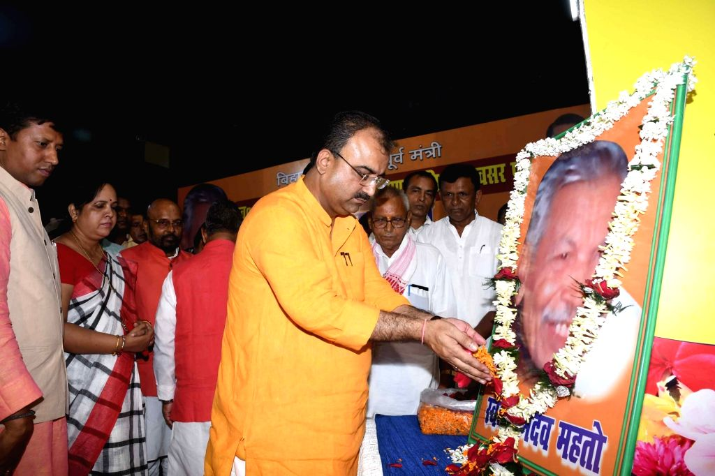 Bihar Minister Mangal Pandey pays tributes to Former Bihar Minister Ramdev Mahto during a programme organised on his 12th birth anniversary in Patna on Sep 5, 2019. - Mangal Pandey