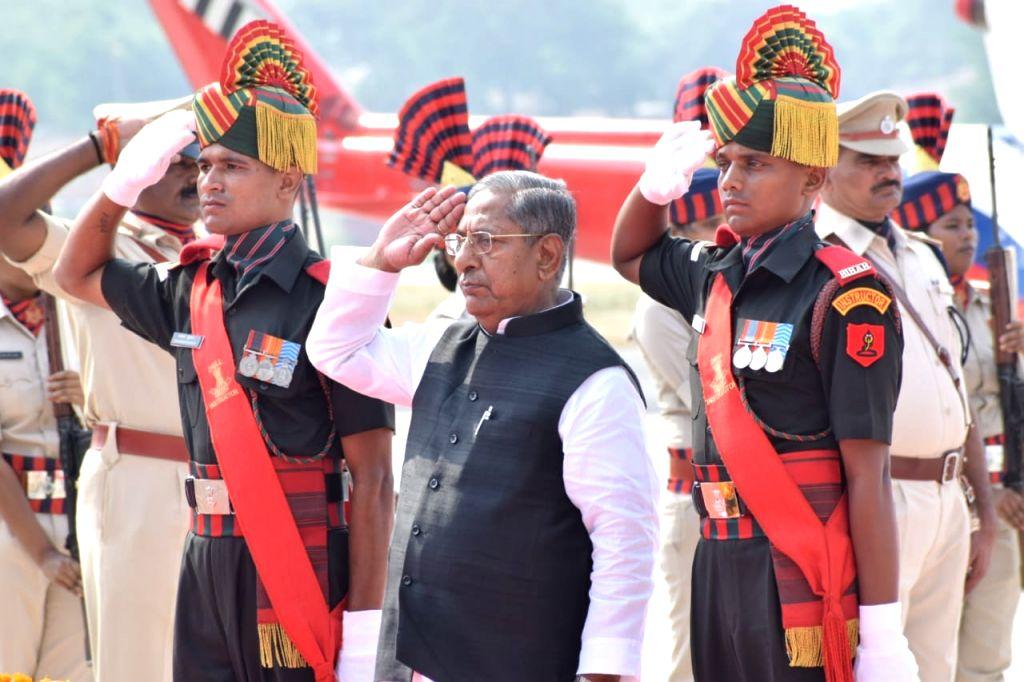 Bihar Minister Nand Kishore Yadav pays tributes to soldier Lance Naik Mohammad Jawed, at the Jay Prakash Narayan International Airport in Patna on June 12, 2019. Jawed was killed when ... - Nand Kishore Yadav