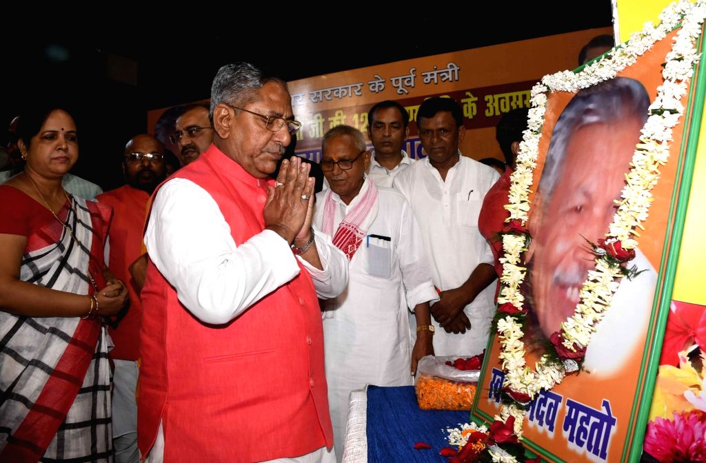 Bihar Minister Nand Kishore Yadav pays tributes to Former Bihar Minister Ramdev Mahto during a programme organised on his 12th birth anniversary in Patna on Sep 5, 2019. - Nand Kishore Yadav