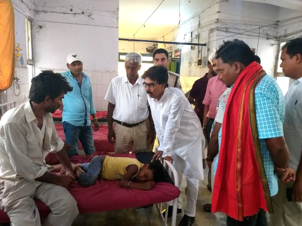 Bihar MLA Mahboob Alam visits children with encephalitis symptoms at a hospital in Muzaffarpur, Bihar on June 15, 2019.