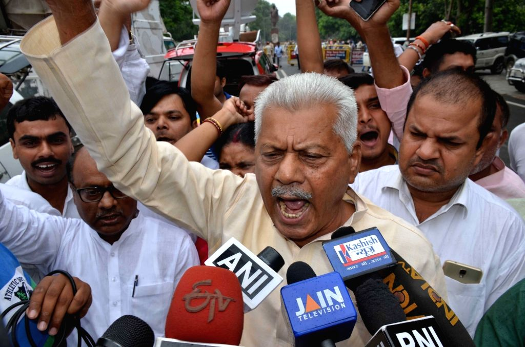 Bihar RJD spokesman Mundrika Singh Yadav talks to press regarding CBI raids at the residences of RJD chief Lalu Prasad and his family members in connection with a new case of alleged ... - Mundrika Singh Yadav