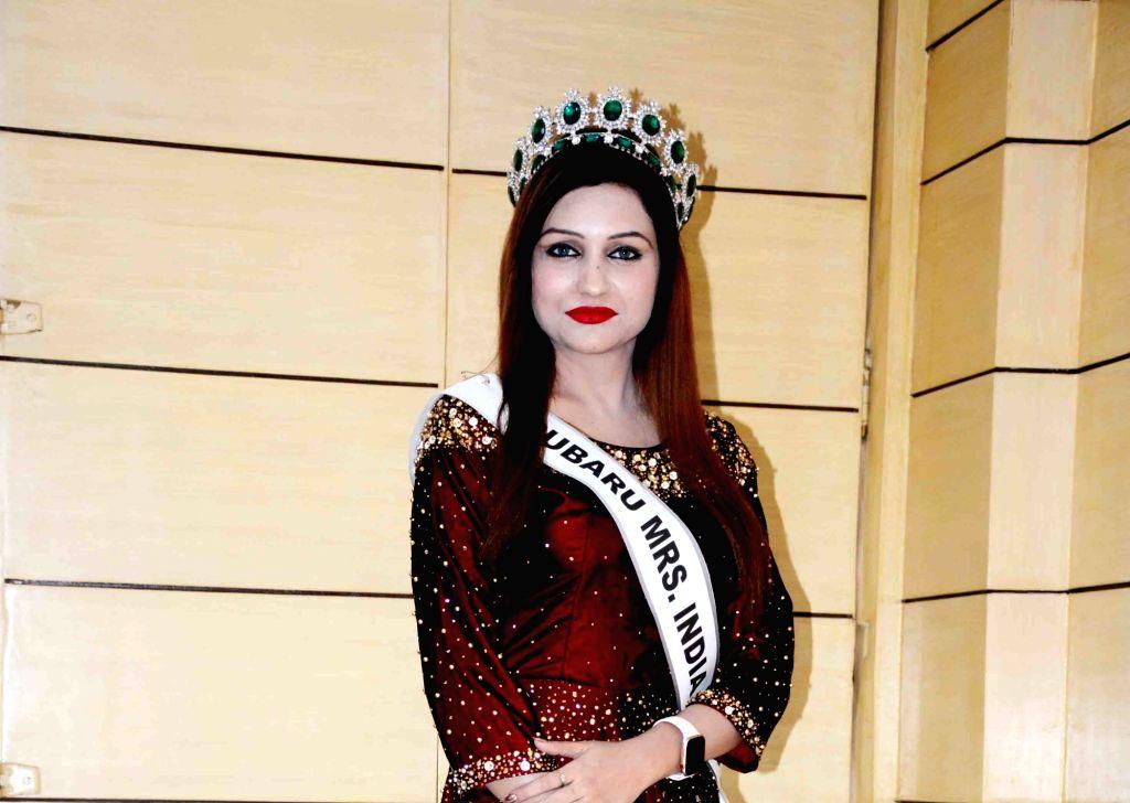 Bihar's Dr. Tara Shweta Arya, winner of Rubaru Mrs. India beauty pageant 2019, at a press conference in Patna on Oct 12, 2019.