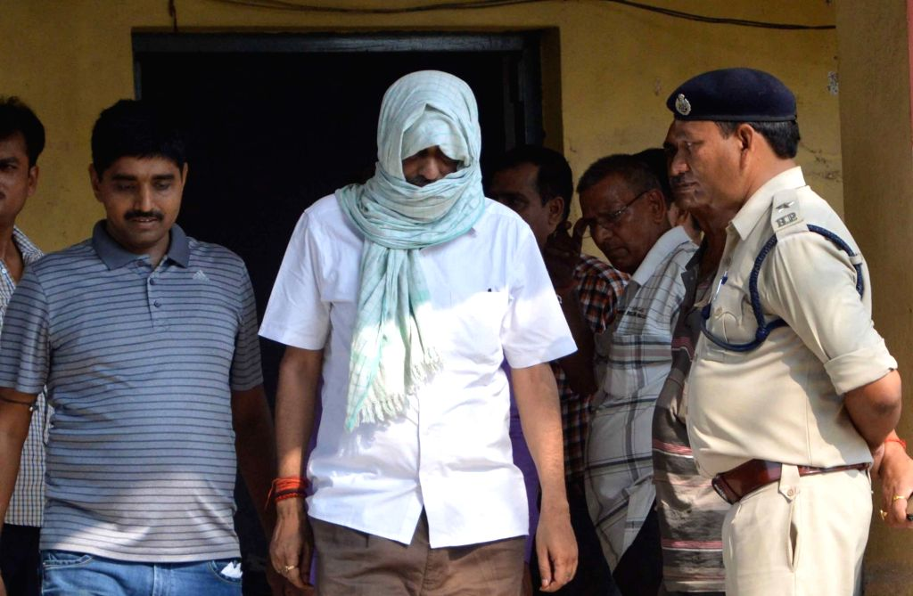 Bihar School Examination Board's former secretary Hariharnath Jha being taken to be produced before a Patna court in connection with toppers scam in Patna on June 27, 2016.