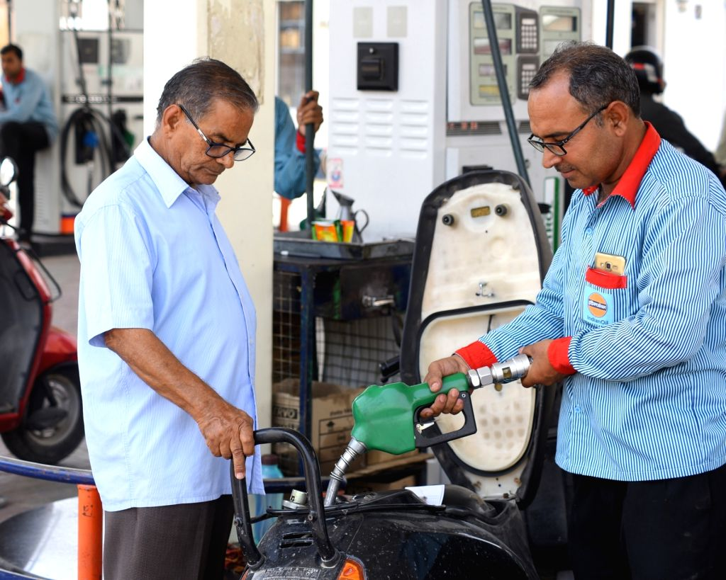 :Bikaner: A man gets the petrol tank of his two-wheeler filled, at a petrol pump, in Bikaner on May 21, 2018. The price of petrol per litre in Delhi on Monday under the dynamic pricing regime ...