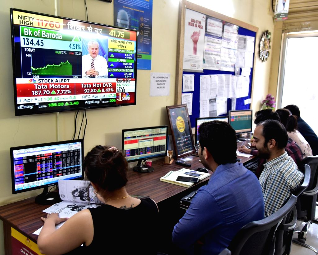 Bikaner: Stock traders monitor share prices in Bikaner, on April 1, 2019. The BSE Sensex on Monday touched a record high and crossed the 39,000 mark for the first time. Around 10.15 a.m., the Sensex hit a fresh record of 38,993 points. (Photo: IANS)