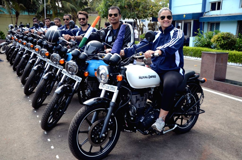 Bikers participate during an Indian Coast Guard Motorcycle Rally to spread awareness about safety at sea, marine environment and coastal security in Mumbai on June 2, 2018.