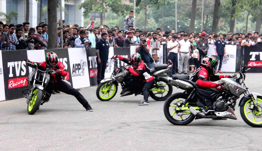 Bikers perform stunt during a programme in Jalandhar on Oct 20, 2015.
