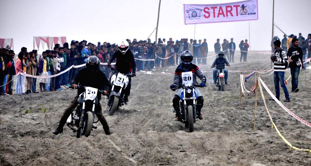 Bikers taking part in the competition during Brahmaputra beach festival at River Brahmaputra beach at Bharalu in Guwahati on Feb. 15, 2014.