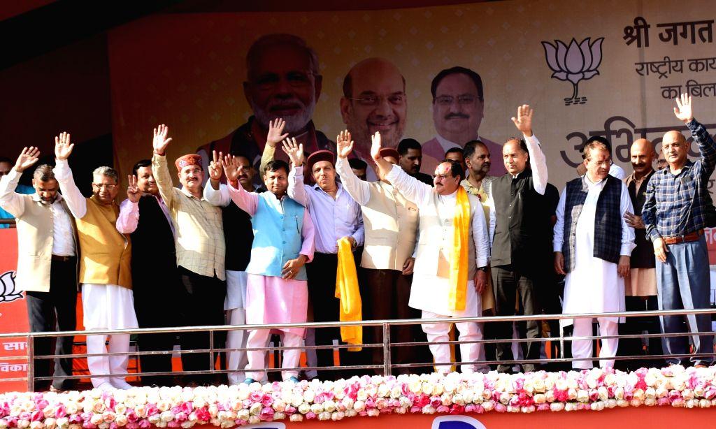 "Bilaspur: BJP National Working President J.P. Nadda with Himachal Pradesh Chief Minister Jai Ram Thakur and State BJP Spokesperson Randhir Sharma during ""Abhinandan Samaroh"" organised to welcome Nadda, at Luhnu Ground in Bilaspur on Oct 7, 2019. (Pho - Jai Ram Thakur and Randhir Sharma"