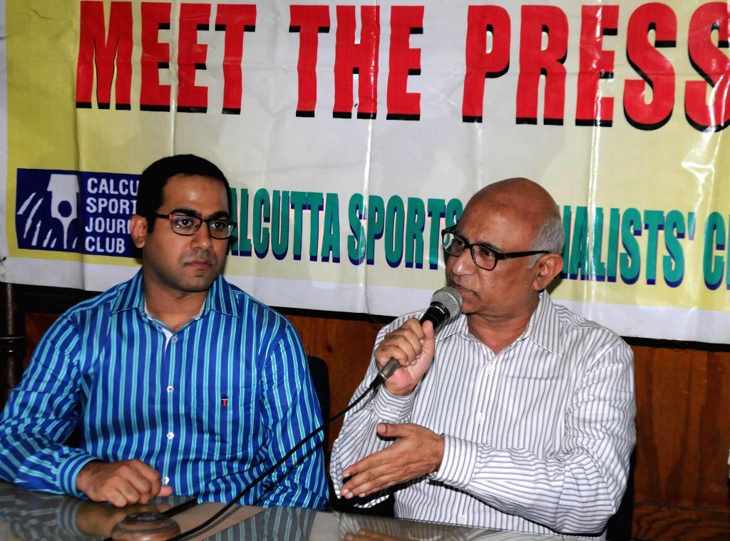 Billiards player Sourav Kothari (Blue) with his father and coach Manoj Kothari  during a press meet in Kolkata on Aug 6, 2014.