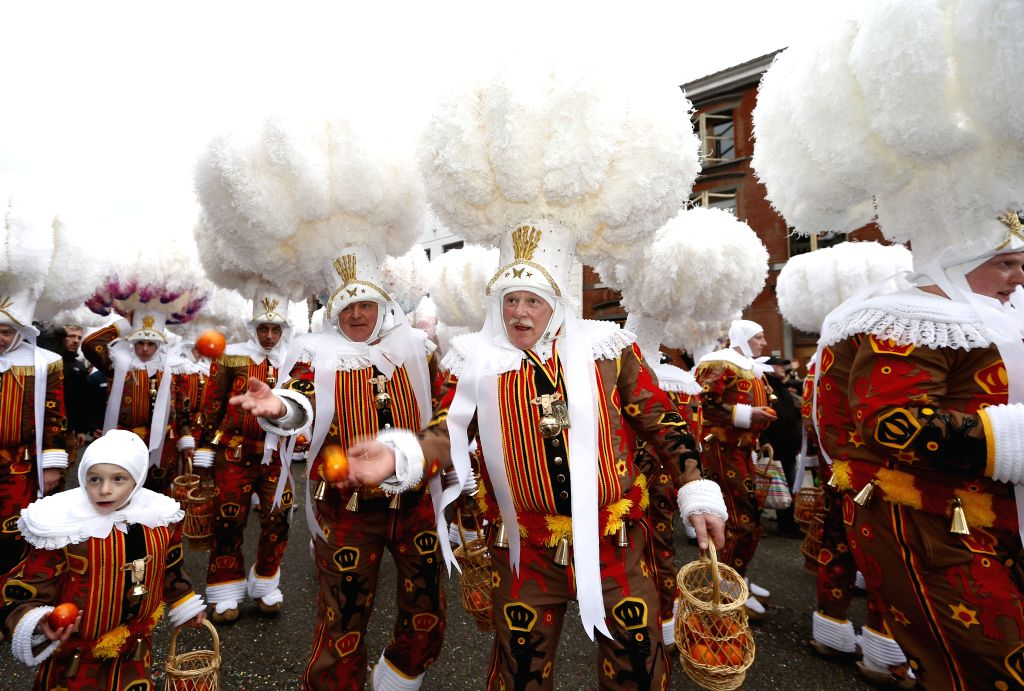 "BINCHE (BELGIUM), Feb. 28, 2017 ""Gilles"" throw oranges symbolizing the coming Spring to visitors, in Binche, Belgium, on Feb. 28, 2017. Binche's three-day carnival, a UNESCO ..."