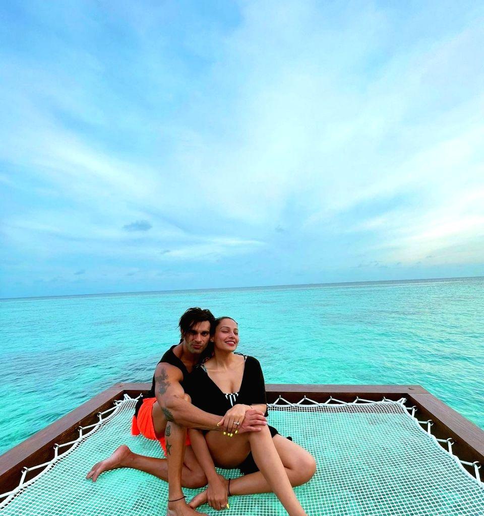 Bipasha Basu, Karan Singh Grover's 'monkey love' in Maldives.(photo:Instagram) - Bipasha Basu and Karan Singh Grove