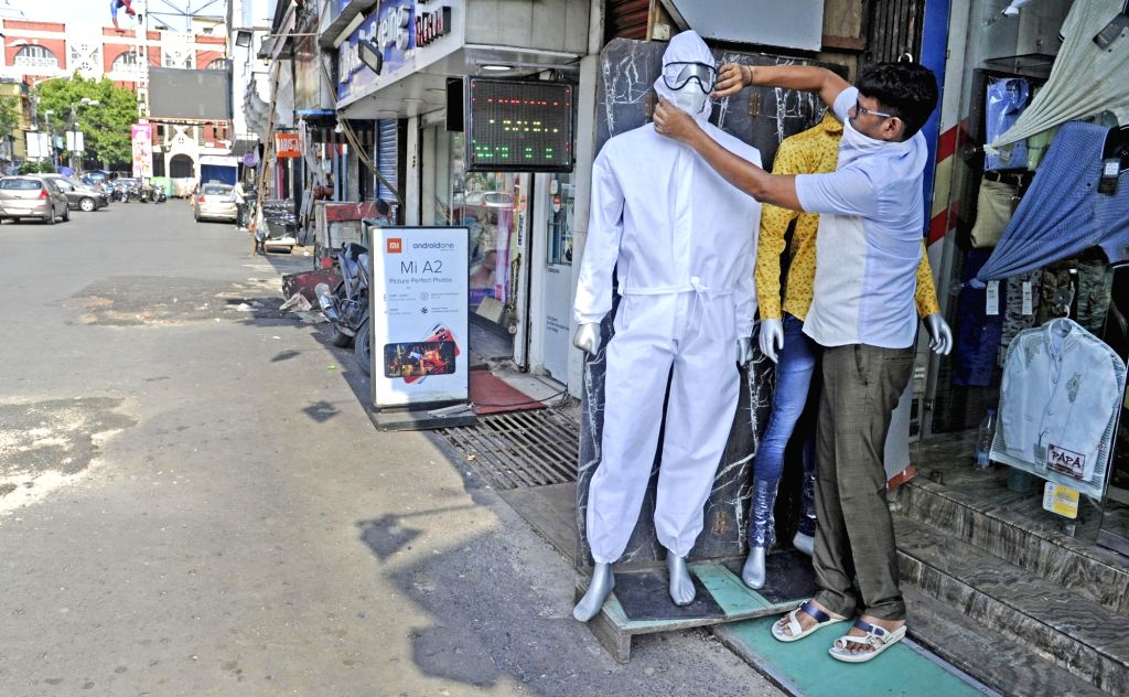 Birbhum: In a unique gesture to sensitise the public to Covid-19 crisis, many shopkeepers in West Bengal's Birbhum district have put up mannequins sporting face masks and PPE kits in the show windows. With Durga Puja round the corner, shopkeepers sel