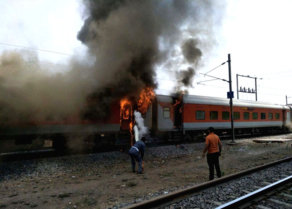 :Birlanagar: A.P. Express, at least two coaches of which caught fire near Birlanagar in Madhya Pradesh on May 21, 2018. According to a Railway Ministry official, the fire was detected in the B-6 ...