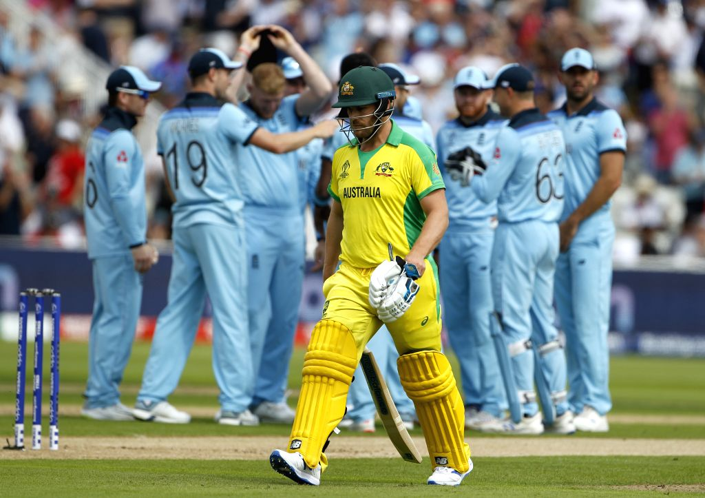 Birmingham: Australian captain Aaron Finch walks back to the pavilion after getting dismissed during the second semi-final match of the 2019 World Cup between Australia and England at the Edgbaston Cricket Stadium in Birmingham, England on July 11, 2 - Aaron Finch and Surjeet Kumar