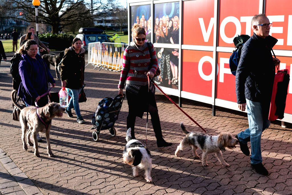 BIRMINGHAM (BRITAIN), March 9, 2017 Dog owners and their dogs arrive for the annual Crufts dog show in Birmingham, Britain, on March 9, 2017.