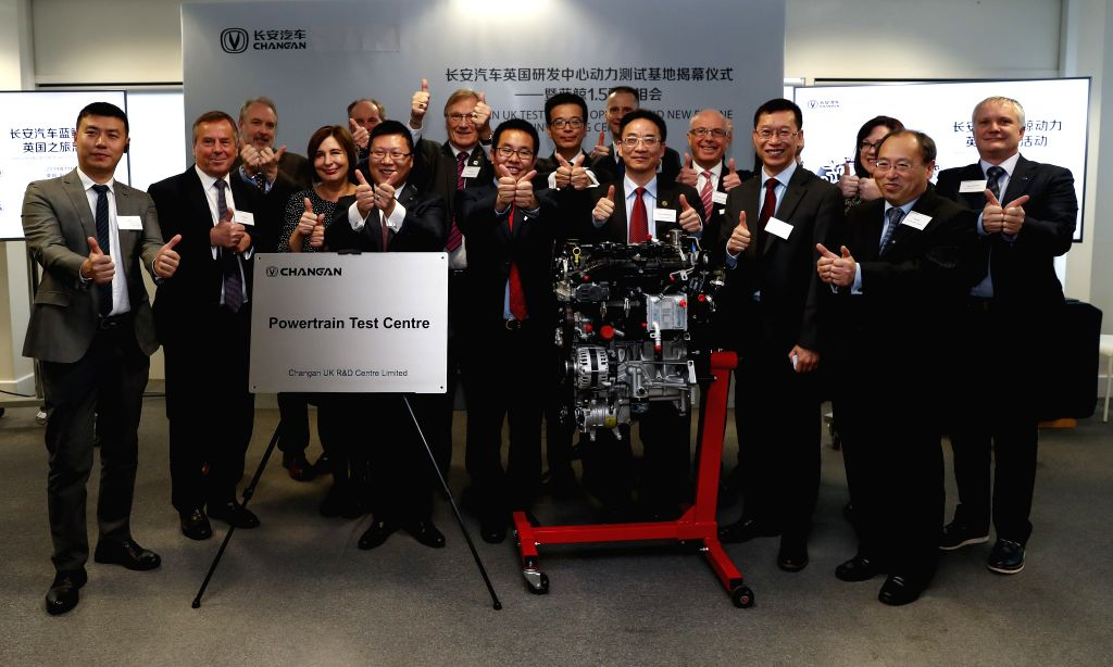 BIRMINGHAM (BRITAIN), Nov. 12, 2019 Guests pose for a group photo during the Changan UK Test Center Opening and New Engine Unveiling Ceremony in Birmingham, Britain, on Nov. 12, 2019. A ...