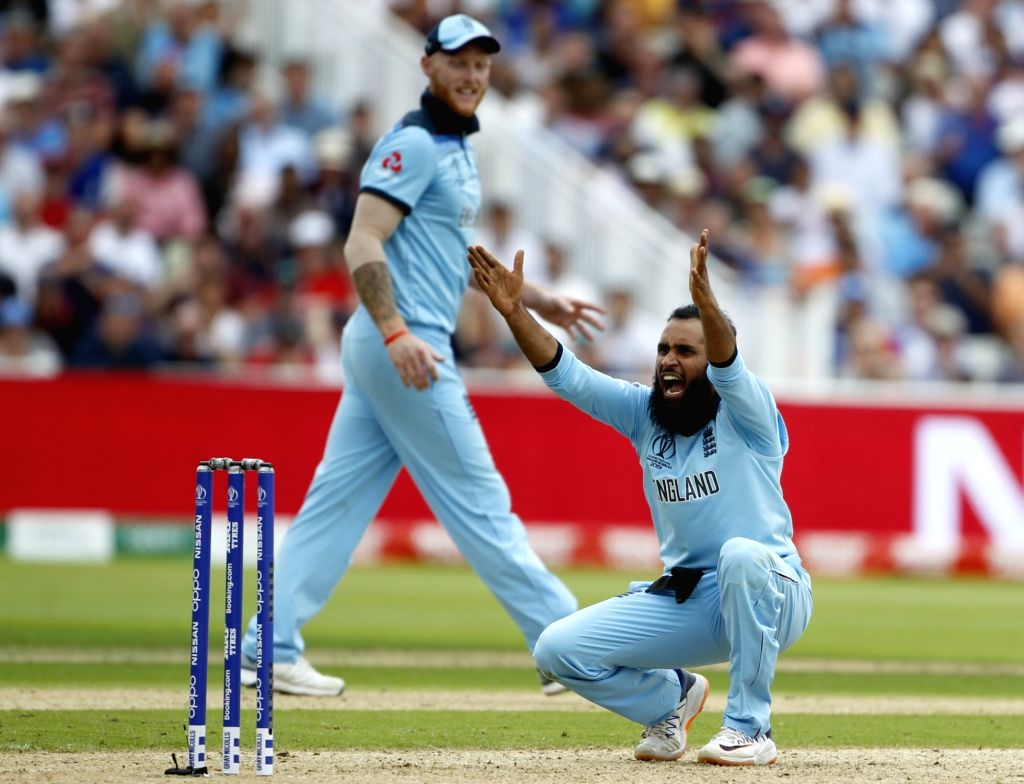 Birmingham: England's Adil Rashid celebrates the wicket of Marcus Stoinis during the second semi-final match of the 2019 World Cup between England and Australia at the Edgbaston Cricket Stadium in Birmingham, England on July 11, 2019. Also seen Engla - Eoin Morgan and Surjeet Kumar
