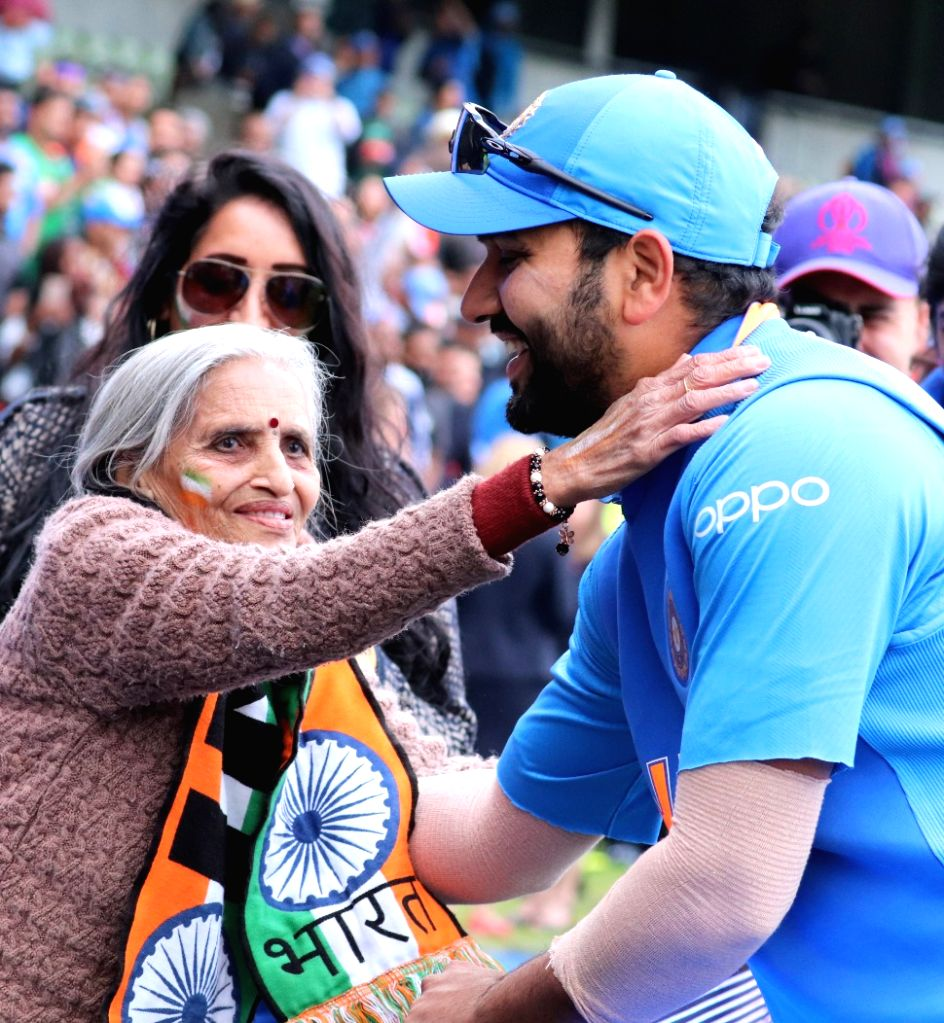 Birmingham: India opener Rohit Sharma greets 87-year-old Charulata Patel, who became a social media sensation after an image of her blowing a horn to cheer the Men in Blue during their World Cup match against Bangladesh went viral, at the Edgbaston C - Rohit Sharma and Charulata Patel