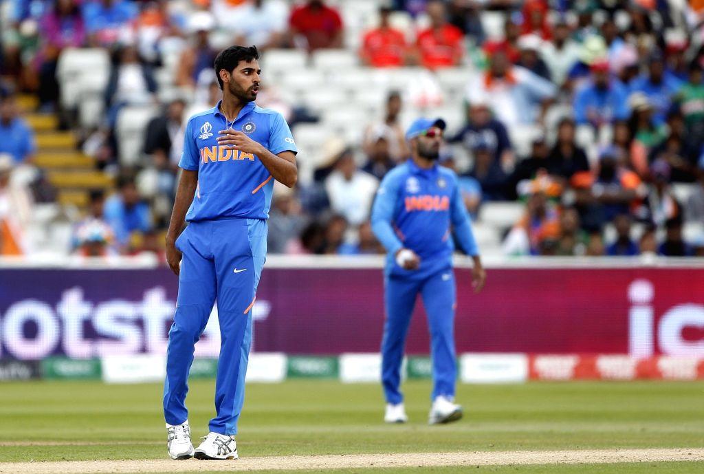 Birmingham: India's Bhuvneshwar Kumar during the 40th match of World Cup 2019 between India and Bangladesh at Edgbaston stadium in Birmingham, England on July 2, 2019. (Photo: Surjeet Yadav/IANS) - Bhuvneshwar Kumar and Surjeet Yadav