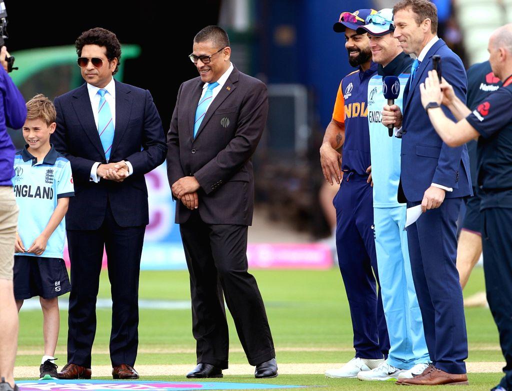 Birmingham: India's captain Virat Kohli and England's caption Eoin Morgan during the toss for the 38th match of World Cup 2019, at Edgbaston stadium in Birmingham, England, on June 30, 2019. Also seen former Indian cricketer Sachin Tendulkar.(Photo:  - Virat Kohli, Sachin Tendulkar and Surjeet Yadav