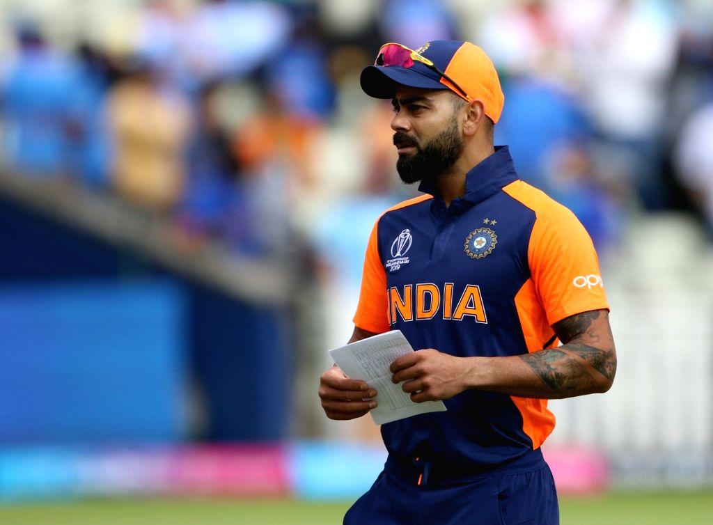 Birmingham: India's captain Virat Kohli during the 38th match of World Cup 2019, at Edgbaston stadium in Birmingham, England, on June 30, 2019.(Photo: Surjeet Yadav/IANS) - Virat Kohli and Surjeet Yadav