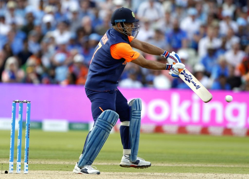 Birmingham: India's MS Dhoni in action during the 38th match of World Cup 2019 between India and England at Edgbaston stadium in Birmingham, England, on June 30, 2019. (Photo: Surjeet Yadav/IANS) - MS Dhoni and Surjeet Yadav
