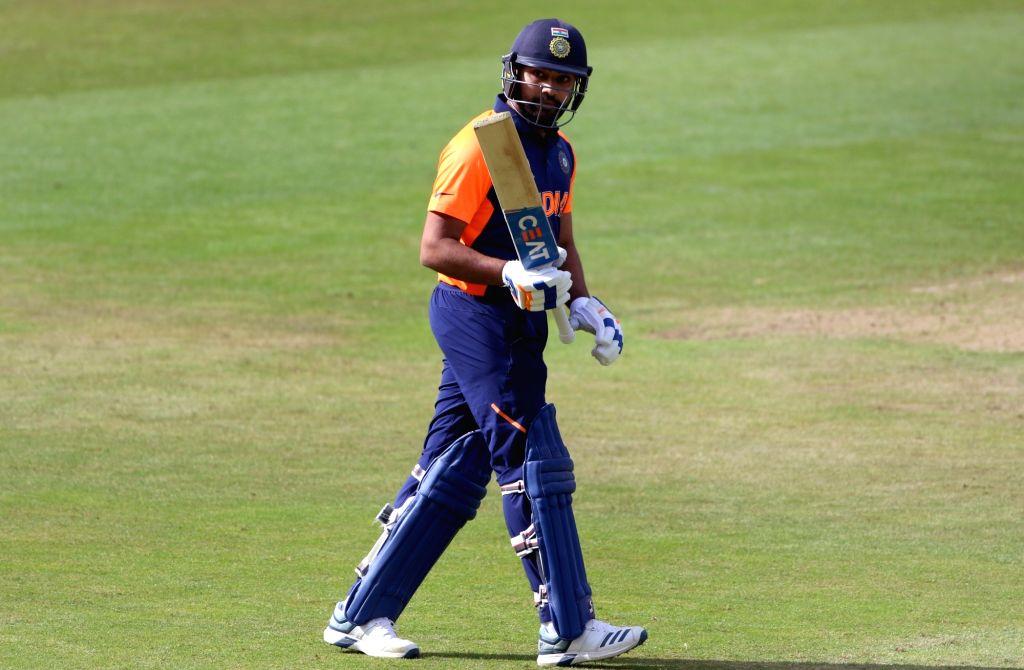 Birmingham: India's Rohit Sharma celebrates his century during the 38th match of World Cup 2019 between India and England at Edgbaston stadium in Birmingham, England, on June 30, 2019. (Photo: Surjeet Yadav/IANS) - Rohit Sharma and Surjeet Yadav