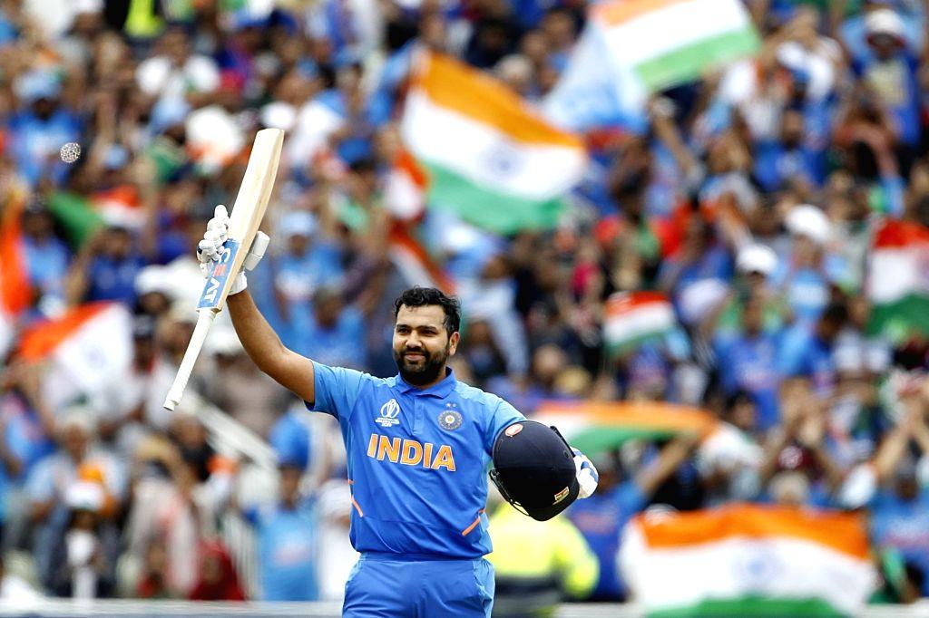 Birmingham: India's Rohit Sharma celebrates his century during the 40th match of World Cup 2019 between India and Bangladesh at Edgbaston stadium in Birmingham, England on July 2, 2019. (Photo: Surjeet Yadav/IANS) - Rohit Sharma and Surjeet Yadav