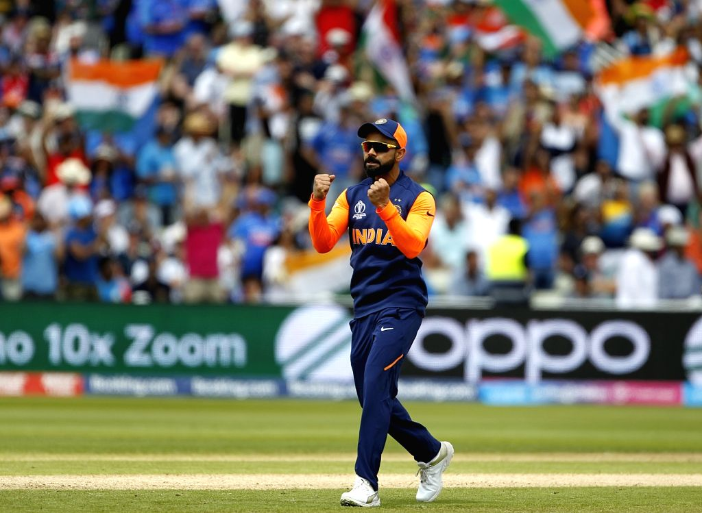 Birmingham: India's skipper Virat Kohli celebrates fall of Eoin Morgan's wicket during the 38th match of World Cup 2019 between India and England at Edgbaston stadium in Birmingham, England, on June 30, 2019. (Photo: Surjeet Yadav/IANS) - Virat Kohli and Surjeet Yadav