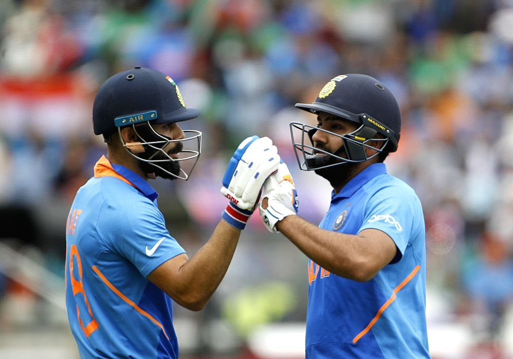 Birmingham: India's Virat Kohli and Rohit Sharma during the 40th match of World Cup 2019 between India and Bangladesh at Edgbaston Stadium in Birmingham, England on July 2, 2019. (Photo: Surjeet Yadav/IANS) - Virat Kohli, Rohit Sharma and Surjeet Yadav
