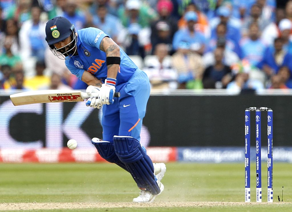 Birmingham: India's Virat Kohli in action during the 40th match of World Cup 2019 between India and Bangladesh at Edgbaston stadium in Birmingham, England on July 2, 2019. (Photo: Surjeet Yadav/IANS) - Virat Kohli and Surjeet Yadav