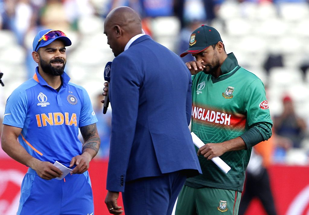 Birmingham: India skipper Virat Kohli and Bangladesh captain Mashrafe Mortaza during toss ahead of the 40th match of World Cup 2019 between India and Bangladesh at Edgbaston stadium in Birmingham, England on July 2, 2019. (Photo: Surjeet Yadav/IANS) - Mashrafe Mortaza, Virat Kohli and Surjeet Yadav