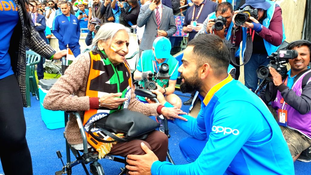 Birmingham: India skipper Virat Kohli greets 87-year-old Charulata Patel, who became a social media sensation after an image of her blowing a horn to cheer the Men in Blue during their World Cup match against Bangladesh went viral, at the Edgbaston C - Virat Kohli and Charulata Patel