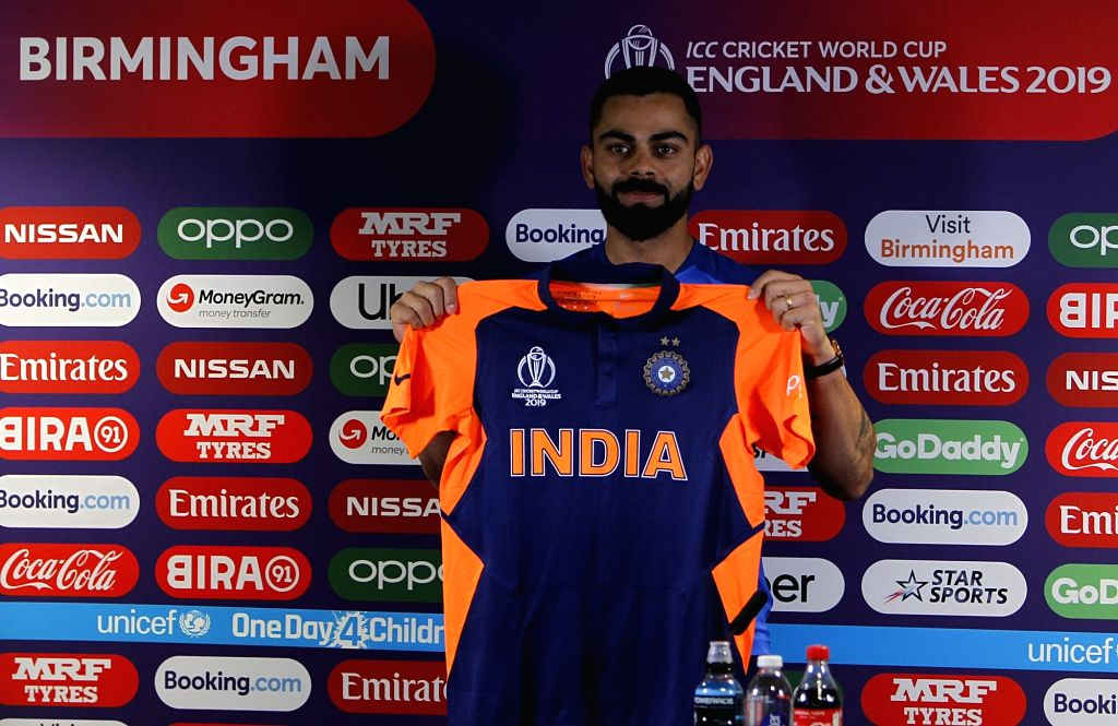 Birmingham: Indian captain Virat Kohli unveils the new new 'away jersey' of team India which has splattering of orange on the shoulders and the back. The Indian cricket team will be seen in a new avatar when they will face England in a much-anticipat - Virat Kohli and Surjeet Yadav