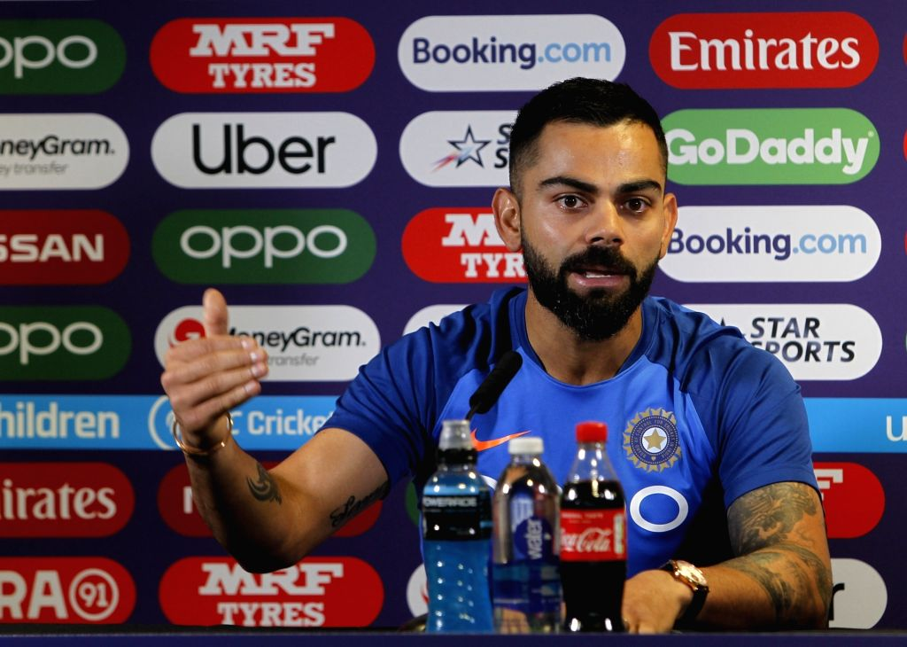 Birmingham: Indian skipper Virat Kohli addresses a press conference ahead of a 2019 World Cup match against England at Edgbaston Stadium in Birmingham, England on June 29, 2019. (Photo: Surjeet Yadav/IANS) - Virat Kohli and Surjeet Yadav