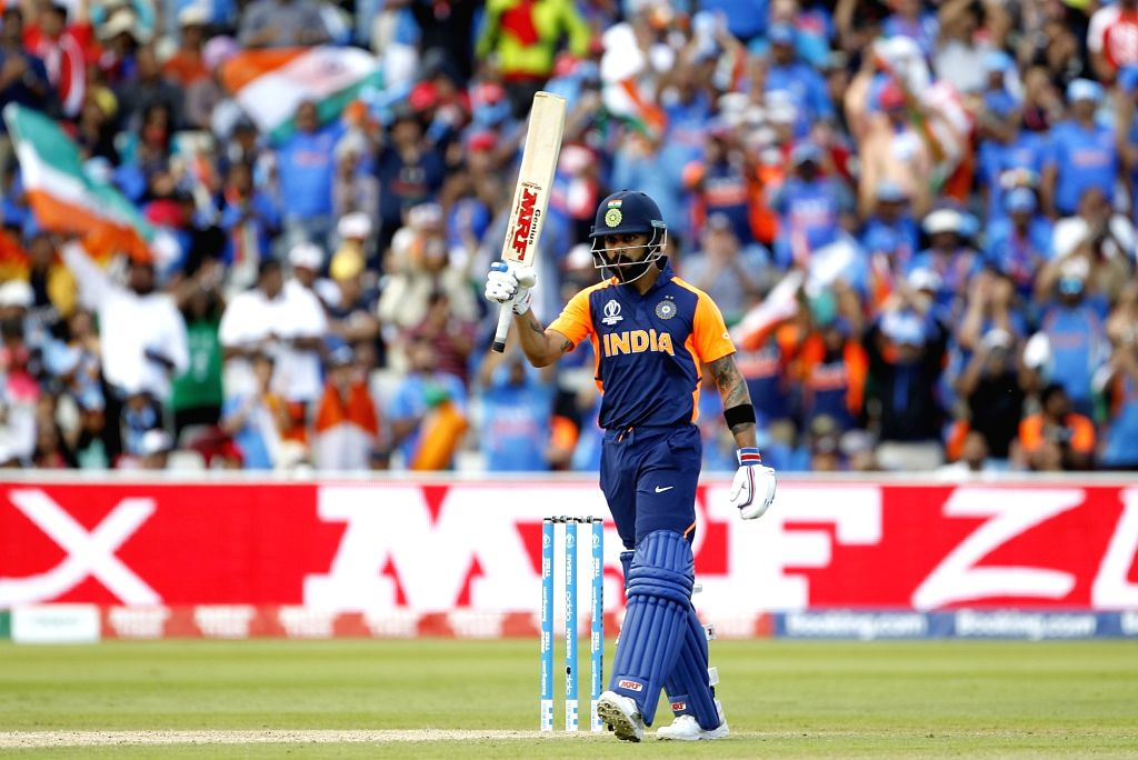 Birmingham: Indian skipper Virat Kohli celebrates his half century during the 38th match of World Cup 2019 between India and England at Edgbaston stadium in Birmingham, England, on June 30, 2019. (Photo: Surjeet Yadav/IANS) - Virat Kohli and Surjeet Yadav