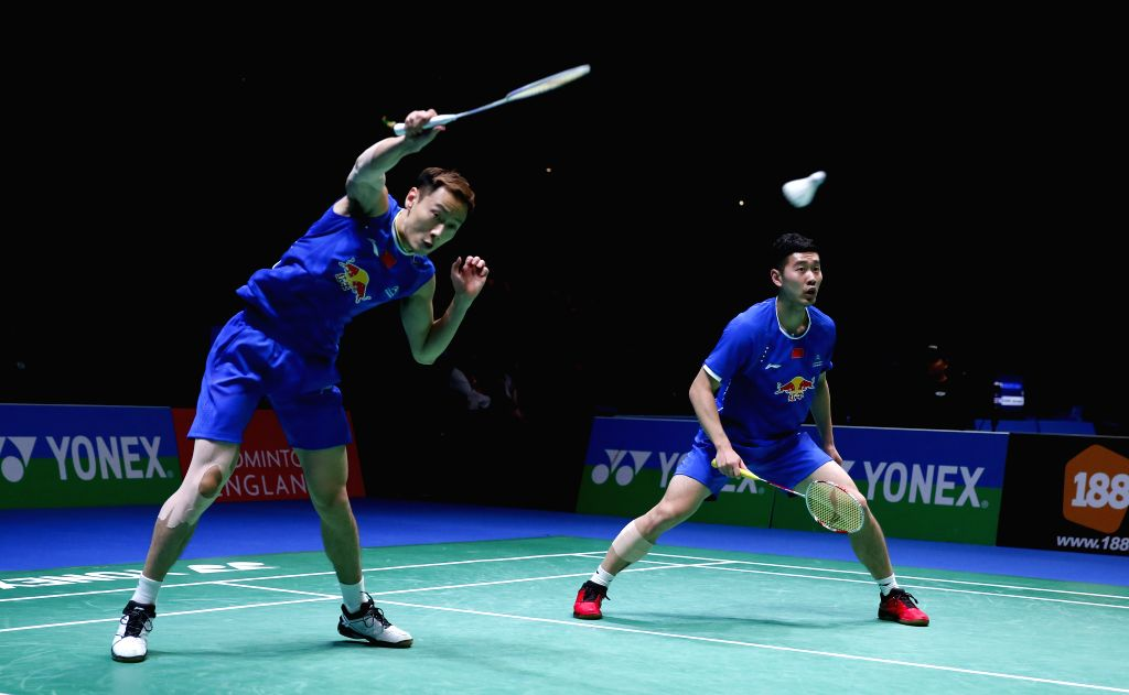 BIRMINGHAM, Mar. 11, 2017 - Liu Cheng/Zhang Nan (L) of China compete during the men's doubles semifinal against their teammates Li Junhui/Liu Yuchen at All England Open Badminton Championships 2017 ...